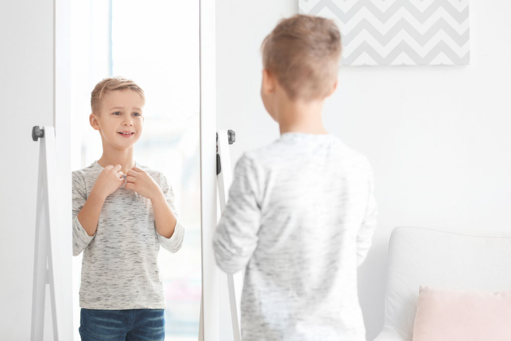 boy looking at mirror
